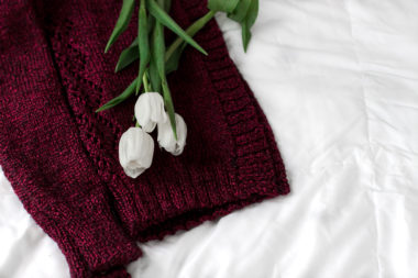 Details of a crimson red knitted sweater